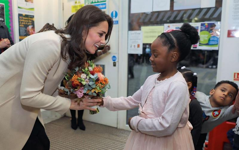 """Kate played and painted with little kids at the centre and was reportedly heard saying that kids' activities are the """"best fun"""". Photo: Getty Images"""