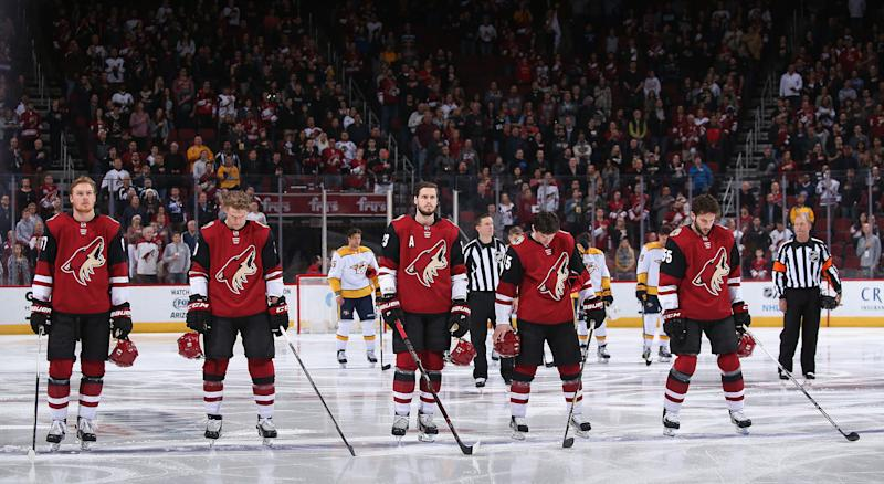 The Arizona Coyotes stand attended for the national anthem before the NHL game against the Nashville Predators at Gila River Arena on January 4, 2018 in Glendale, Arizona. The Coyotes defeated the Predators 3-2 in overtime. (Photo by Christian Petersen/Getty Images)