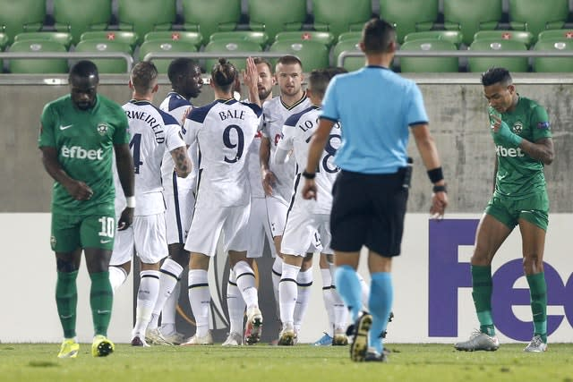 Harry Kane, centre, is congratulated by his Spurs team-mates after he reached 200 goals for the club with a header in the 3-1 win at Ludogorets