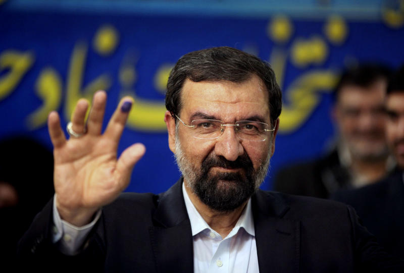 Former chief of Iran's Revolutionary Guard, Mohsen Rezaei, a hopeful for the upcoming presidential election, waves to media, after registering his candidacy, at the election headquarters of interior ministry in Tehran, Iran, Friday, May 10, 2013. The five-day registration period for candidates in next month's election opened on Tuesday. The election overseers, known as the Guardian Council, will announce the handful of candidates on the ballot later this month. The June 14 election will pick a successor to President Mahmoud Ahmadinejad. (AP Photo/Vahid Salemi)