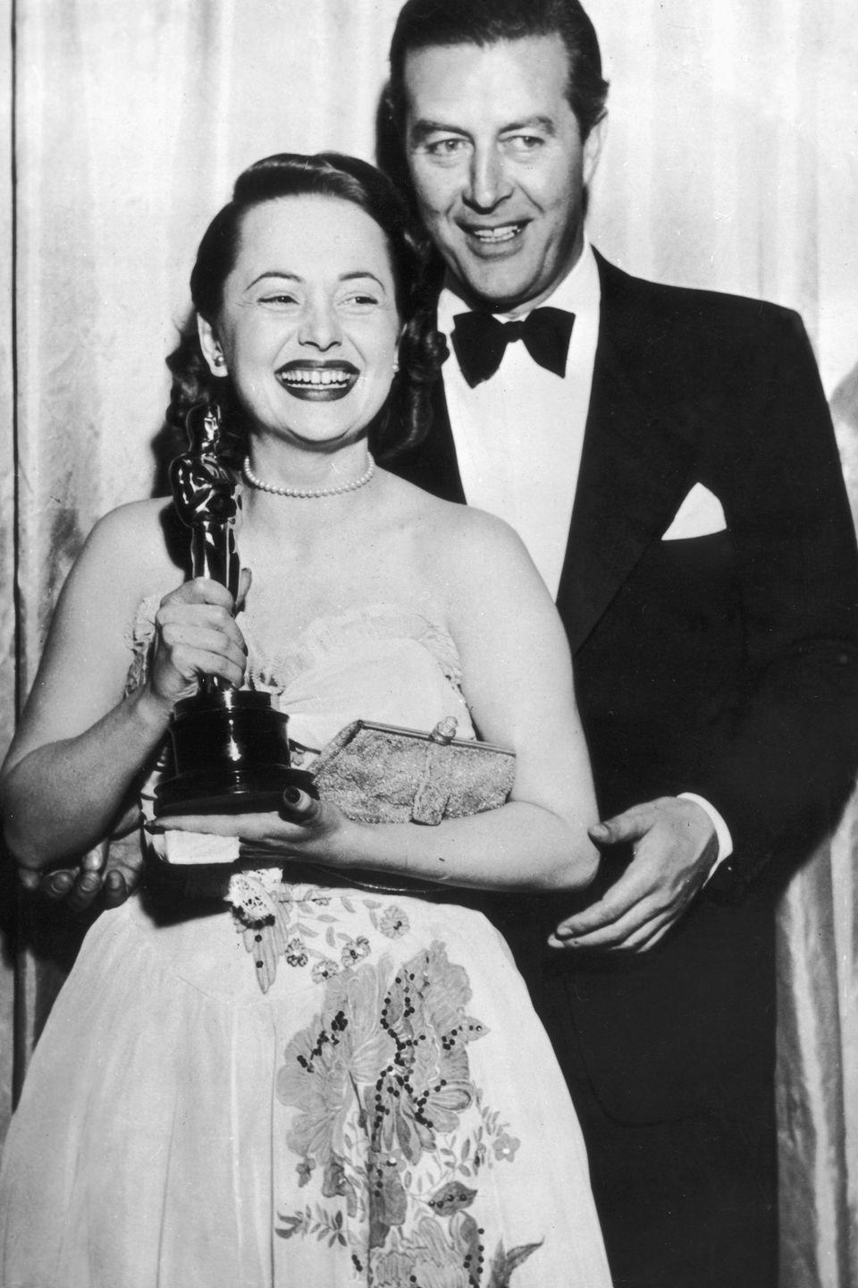 <p>Accepting her Best Actress Oscar from actor Ray Milland for her performance in <em>To Each His Own</em>.</p>