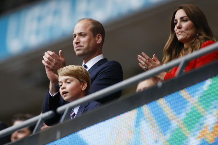 Prince William, pictured with wife Kate and son George at a UEFA EURO 2020 match in London on 29 June 2021, has spoken about his son's understanding of climate change. (Getty Images)