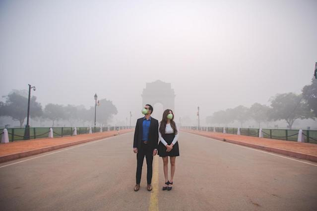 The couple in the smog-filled city. (Photo: Banjara Studios)
