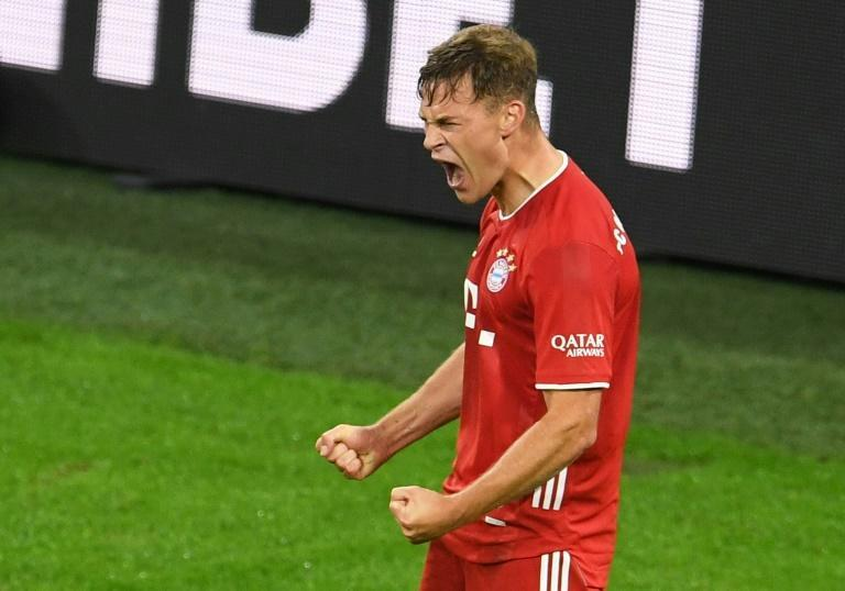 Joshua Kimmich celebrates scoring the winning goal for Bayern Munich