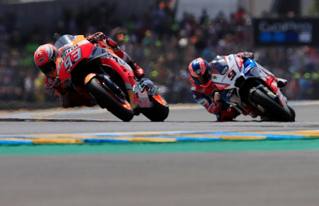 Motorcycling - MotoGP - French Grand Prix - Bugatti Circuit, Le Mans, France - May 20, 2018 Repsol Honda Team's Marc Marquez and Alma Pramac Racing's Danilo Petrucci during the race REUTERS/Gonzalo Fuentes