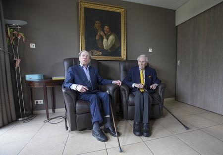 The world's oldest living twin brothers, Paulus (L) and Pieter Langerock from Belgium, 102, sit in their living room at the Ter Venne care home in Sint-Martens-Latem, Belgium August 11, 2015. REUTERS/Yves Herman