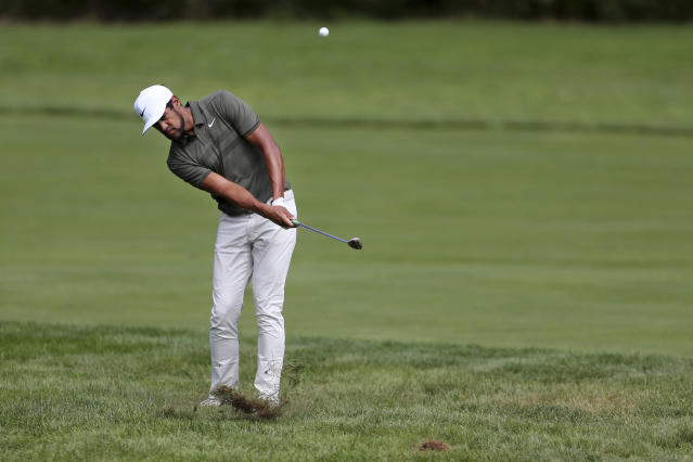 Tony Finau hits a fairway shot on the third hole during the final round of the Northern Trust golf tournament, Sunday, Aug. 26, 2018, in Paramus, N.J. (AP Photo/Mel Evans)