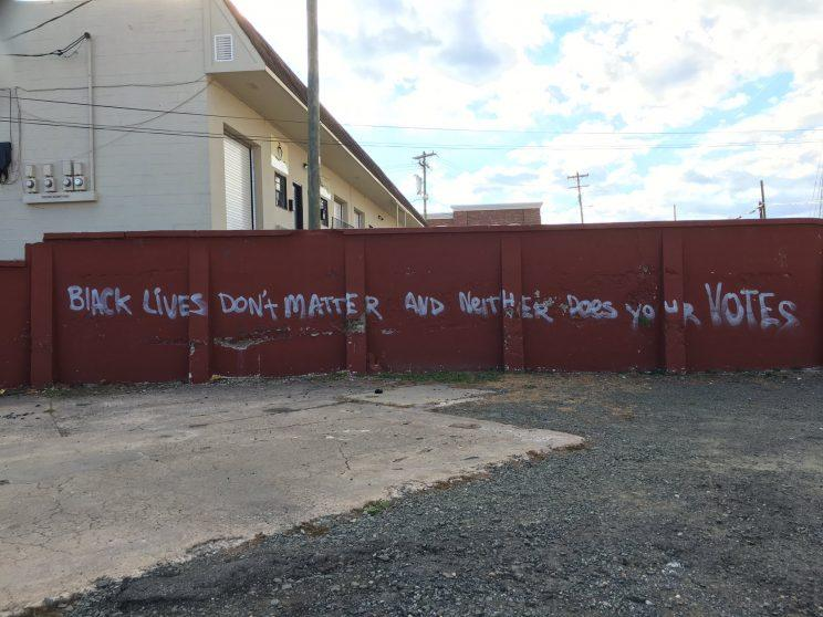 """""""Black lives don't matter and neither does your votes,"""" was spray-painted across a wall in Durham, North Carolina. (Photo: Derrick Lewis via Twitter)"""