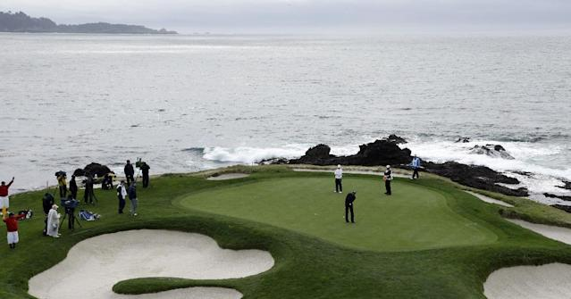 Jimmy Walker putts on the seventh green Sunday, Feb. 9, 2014, during the final round of the AT&T Pebble Beach Pro-Am golf tournament in Pebble Beach, Calif. (AP Photo/Ben Margot)