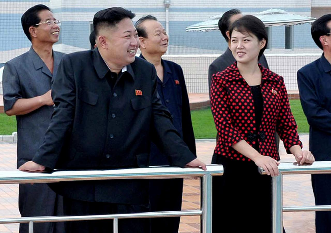In this undated photo released by the Korean Central News Agency (KCNA) and distributed in Tokyo by the Korea News Service Thursday, July 26, 2012, North Korean leader Kim Jong Un, front left, accompanied by his wife Ri Sol Ju, front right, inspects the Rungna People's Pleasure Ground in Pyongyang. North Korea said its new, young leader Kim Jong Un is married, announcing it for the first time in a brief and routine state TV report Wednesday evening that ends weeks of speculation about a beautiful woman who accompanied him to recent public events. (AP Photo/Korean Central News Agency via Korea News Service) JAPAN OUT UNTIL 14 DAYS AFTER THE DAY OF TRANSMISSION