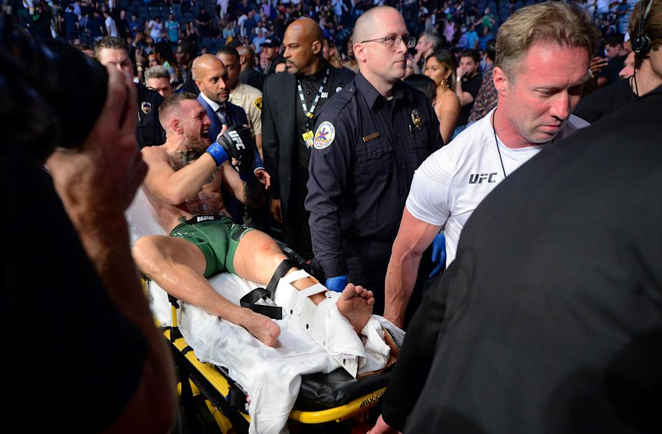 Jul 10, 2021; Las Vegas, Nevada, USA; Conor McGregor is carried off a stretcher following an injury suffered against Dustin Poirier during UFC 264 at T-Mobile Arena. Mandatory Credit: Gary A. Vasquez-USA TODAY Sports     TPX IMAGES OF THE DAY