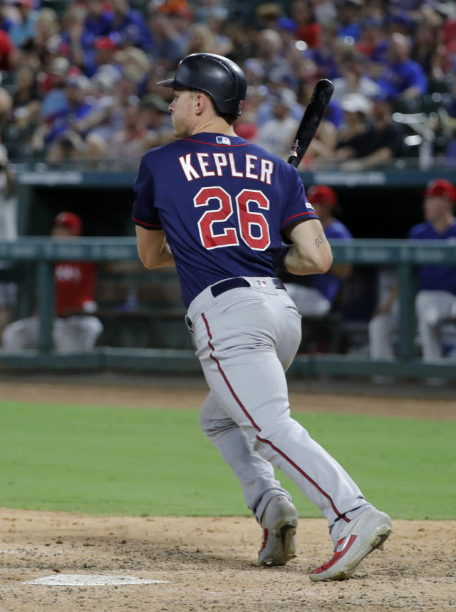 Minnesota Twins' Max Kepler follows through on an RBI single during the fifth inning of the team's baseball game against the Texas Rangers in Arlington, Texas, Saturday, Aug. 17, 2019. (AP Photo/Tony Gutierrez)