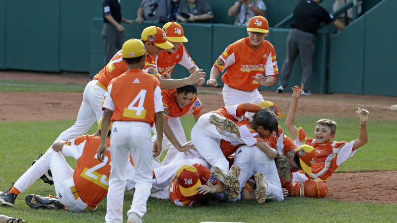 River Ridge, Louisiana celebrates a 8-0 win over Curacao in the Little League World Series Championship game in South Williamsport, Pa., Sunday, Aug. 25, 2019. (AP Photo/Gene J. Puskar)
