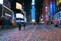 Confetti lies on the street after the Times Square New Year's Eve ball dropped in a nearly empty Times Square early Friday, Jan. 1, 2021, as the area normally packed with revelers was closed because of the ongoing coronavirus pandemic. (AP Photo/Craig Ruttle)