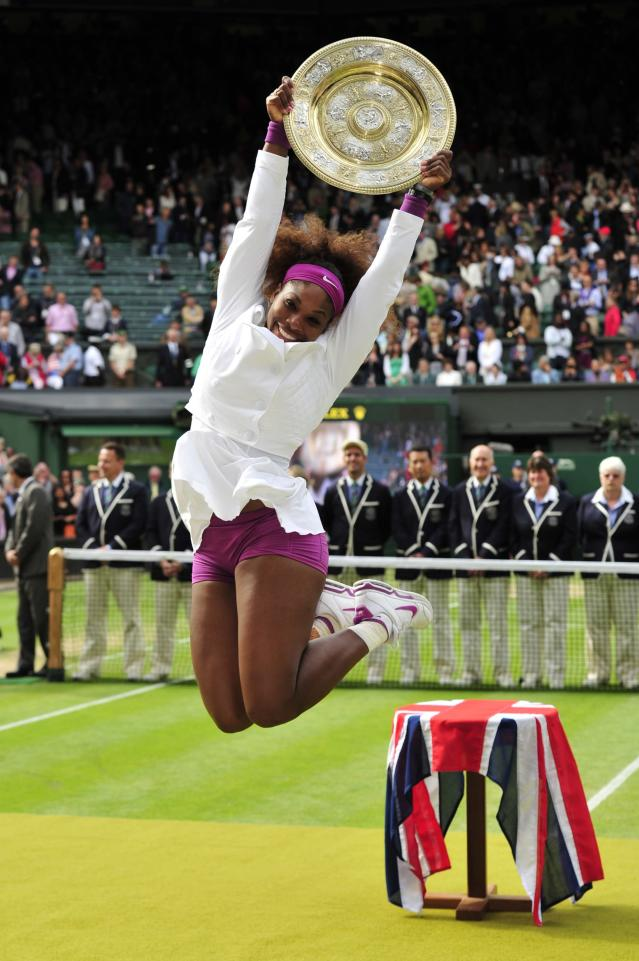 -- AFP PICTURES OF THE YEAR 2012 -- US player Serena Williams celebrates with the trophy, the Venus Rosewater Dish after her women's singles final victory over Poland's Agnieszka Radwanska on day 12 of the 2012 Wimbledon Championships tennis tournament at the All England Tennis Club in Wimbledon, southwest London, on July 7, 2012. Serena Williams won the match 6-1, 5-7, 6-2. AFP PHOTO/ GLYN KIRK RESTRICTED TO EDITORIAL USEGLYN KIRK/AFP/Getty Images