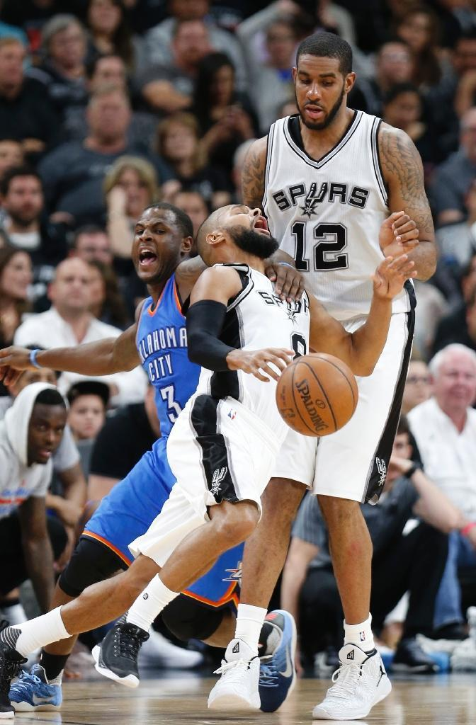 Patty Mills of the San Antonio Spurs is fouled by Dion Waiters of the Oklahoma City Thunder during game two of their NBA Western Conference semi-finals, at AT&T Center in San Antonio, Texas, on May 2, 2016 (AFP Photo/Ronald Cortes)