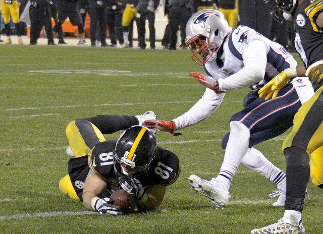 "FILE - In this Sunday, Dec. 17, 2017, file photo, Pittsburgh Steelers tight end Jesse James (81) loses his grip on the football after crossing the goal line on a pass play against the New England Patriots in the closing seconds of the fourth quarter of an NFL football game in Pittsburgh. The NFL has a simplified catch rule designed to eliminate confusion and, the league hopes, controversy about receptions. The committee cited overturned receptions by tight ends James and Zach Miller last season among the dozens of plays they reviewed ""dozens of times,"" according to committee chairman Rick McKay, president of the Atlanta Falcons. (AP Photo/Don Wright, File)"