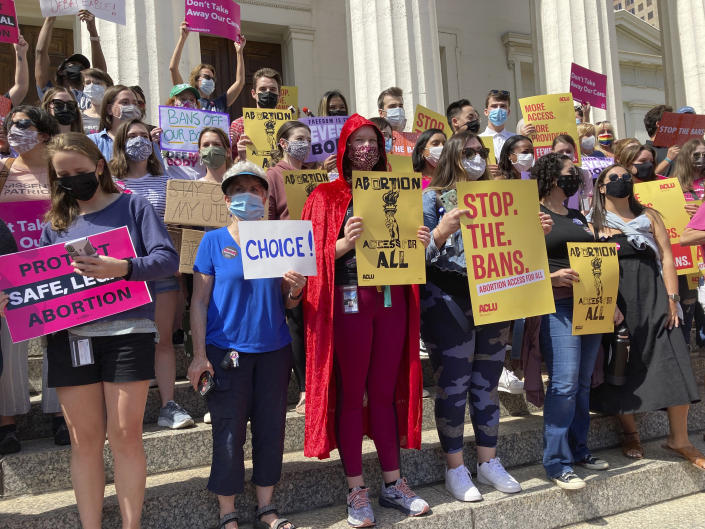 About 200 abortion rights demonstrators gathered outside the Old Courthouse in St. Louis, for a rally on Thursday, Sept. 9, 2021. Speakers warned that Missouri will likely pursue a restrictive abortion law similar to Texas. (AP Photo/Jim Salter)