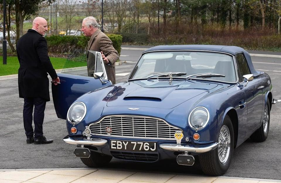 Charles with his Aston Martin DB6 which runs on run on surplus wine (Rebecca Naden/PA) (PA Archive)