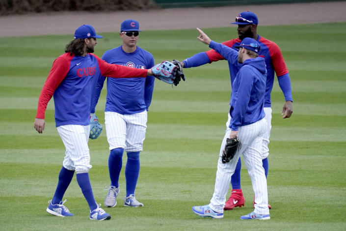 The Chicago Cubs outfielders, from left, Jake Marisnick, Joc Pederson, Jason Heyward, and Ian Happ, come together during the team's last baseball workout Wednesday, March 31, 2021, before opening day Thursday, April 1, 2021, against the Pittsburgh Pirates in Chicago. (AP Photo/Charles Rex Arbogast)