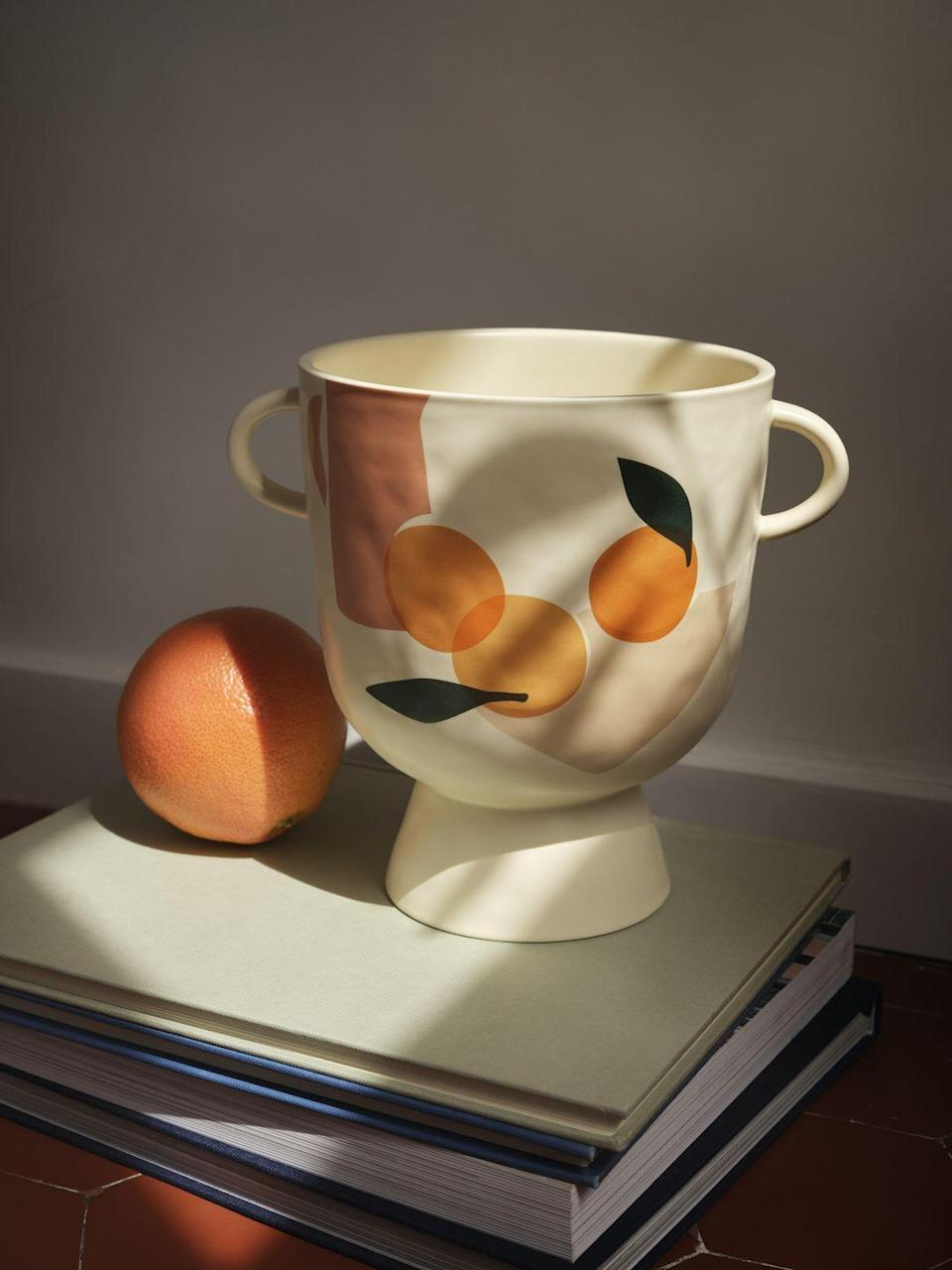 """<p>This beautiful stoneware plant pot created by duo Sacrée Frangine features sun-ripened oranges on a cream background. </p><p>'Our pieces in the collection are gentle reminders to take time. Take time to dream, to contemplate a beautiful landscape, to smile, to spend time with people you love or miss,' say Célia Amroune and Aline Kpade from Sacrée Frangine.</p><p><a class=""""link rapid-noclick-resp"""" href=""""https://www2.hm.com/en_gb/productpage.1009576001.html"""" rel=""""nofollow noopener"""" target=""""_blank"""" data-ylk=""""slk:BUY NOW"""">BUY NOW</a> </p>"""