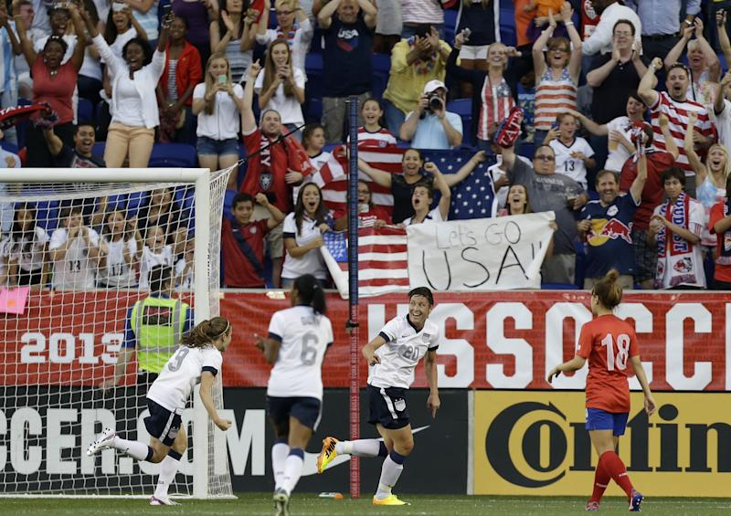 United States' Abby Wambach, center right, reacts after scoring a goal against South Korea as United States' Heather O'Reilly (9) and Crustal Dunn (6) and South Korea's Jeoun Eunha (18) look on during the first half of an international friendly soccer match at Red Bull Arena, Thursday, June 20, 2013, in Harrison, N.J. (AP Photo/Julio Cortez)