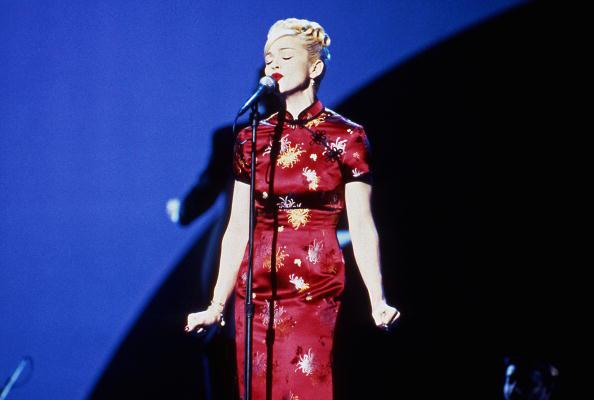 "<div class=""caption-credit""> Photo by: Getty Images</div><div class=""caption-title""></div><b>Madonna performs ""Take A Bow"" at the American Music Awards, 1995</b> <br> The singer loves appropriating other cultures, as evidenced by this Asian-style dress. The video for ""Take a Bow"" had a Spanish bullfighter theme, as she was lobbying for the the starring role in Evita at the time. (She got the part.)"