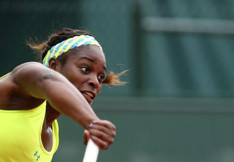 Sloane Stephens, of the U.S, serves the ball to compatriot Vania King during their second round match of the French Open tennis tournament at the Roland Garros stadium Thursday, May 30, 2013 in Paris. (AP Photo/Michel Euler)