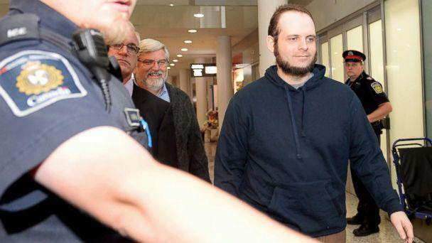 PHOTO: Joshua Boyle is escorted by authorities to a media availability at Toronto's Pearson International Airport on Friday, Oct. 13, 2017. (Nathan Denette/The Canadian Press via AP)