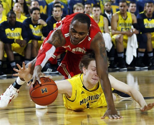 Ohio State forward Deshaun Thomas, top, and Michigan guard Matt Vogrich, bottom, scramble for a loose ball under the basket in the first half of an NCAA college basketball game, Saturday, Feb. 18, 2012, in Ann Arbor, Mich. (AP Photo/Tony Ding)