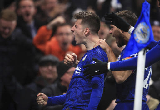 Chelsea's Mason Mount celebrates scoring his side's second goal of the game against Aston Villa during their English Premier League soccer match at Stamford Bridge in London, Wednesday Dec. 4, 2019. (Adam Davy/PA via AP)