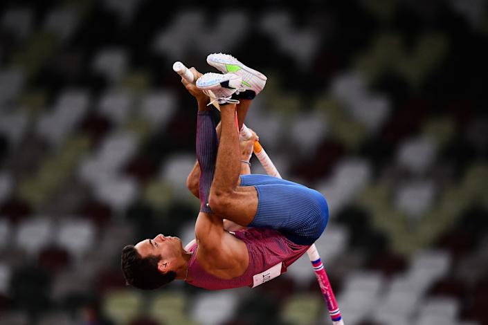 <p>USA's Kc Lightfoot competes in the men's pole vault final during the Tokyo 2020 Olympic Games at the Olympic Stadium in Tokyo on August 3, 2021. (Photo by Ben STANSALL / AFP) (Photo by BEN STANSALL/AFP via Getty Images)</p>