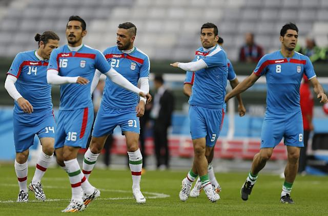 Iran players warm up during an official training session the day before the group F World Cup soccer match between Iran and Nigeria at the Arena da Baixada in Curitiba, Brazil, Sunday, June 15, 2014. (AP Photo/Frank Augstein)