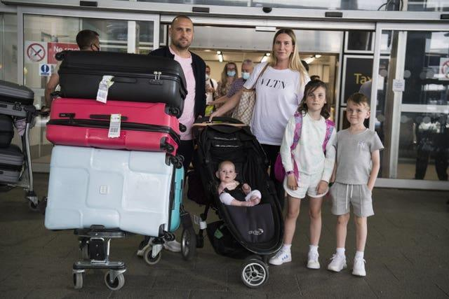 Paul and Jemma Nevard and their children at Gatwick