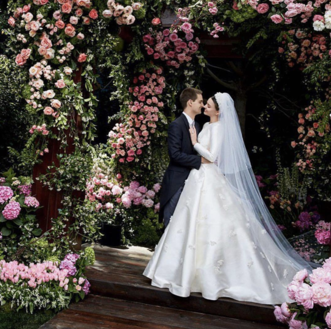 <p><span>Inspired by Grace Kelly's iconic 1959 wedding dress, the Australian model asked Dior's first female artistic director, Maria Grazia Chiuri, to concoct a gown to be remembered. </span><span>The resulting dress featured long sleeves and a high neck and was appliquéd with dainty lilies of the valley. Miranda finished off the stunning look with a long white veil and floral headband.<br /><em>[Photo: Instagram/Miranda Kerr]</em></span> </p>