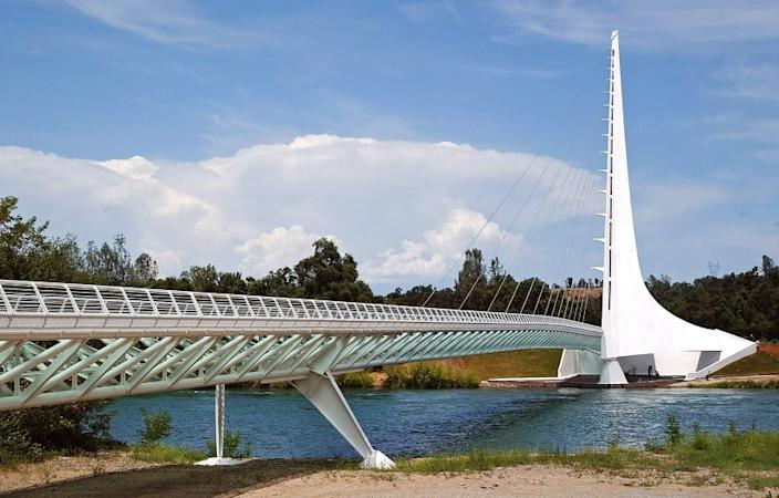** ADVANCE FOR THE WEEKEND OF JULY, 3-4 **The Sun Dial Bridge is seen from the Sacramento River, Monday, June 28, 2004, in Redding, Calif. The 700-foot-long, 23-foot-wide footbridge was designed by world-famous architect, engineer and artist Santiago Calatrava, who also designed the Olympic Sports Complex for the Athens 2004 Summer Games. (AP Photo/Ben Margot)