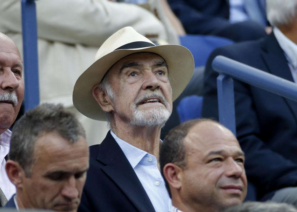 Actor Sean Connery sits in the crowd watching Novak Djokovic of Serbia play Marin Cilic of Croatia during their men's singles semi-final match at the U.S. Open Championships tennis tournament in New York, September 11, 2015. REUTERS/Mike Segar