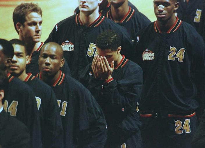 """<span class=""""caption"""">Mahmoud Abdul-Rauf bows his head in prayer during the singing of the national anthem.</span> <span class=""""attribution""""><a class=""""link rapid-noclick-resp"""" href=""""https://www.gettyimages.com/detail/news-photo/denver-nuggets-guard-mahmoud-abdul-rauf-bows-his-head-in-news-photo/51975529?adppopup=true"""" rel=""""nofollow noopener"""" target=""""_blank"""" data-ylk=""""slk:Eric Chu/AFP via Getty Images"""">Eric Chu/AFP via Getty Images</a></span>"""