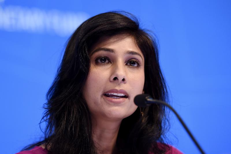 "Gita Gopinath, IMF Chief Economist and Director of the Research Department, speaks at a briefing during the IMF and World Bank Fall Meetings on October 15, 2019 in Washington, DC. - The world economy is slowing to its weakest pace since the global financial crisis, amid continuing trade conflicts that have undercut business confidence and investment, the IMF said Tuesday. It cut the growth forecast for 2019 to 3.0 percent in its latest World Economic Outlook report, and lowered the 2020 estimate to 3.4 percent. The report warned that the global economy is experiencing ""a synchronized slowdown and uncertain recovery.""International Monetary Fund chief economist Gita Gopinath said ""the global outlook remains precarious"" and warned ""there is no room for policy mistakes."" (Photo by Olivier Douliery / AFP) (Photo by OLIVIER DOULIERY/AFP via Getty Images)"