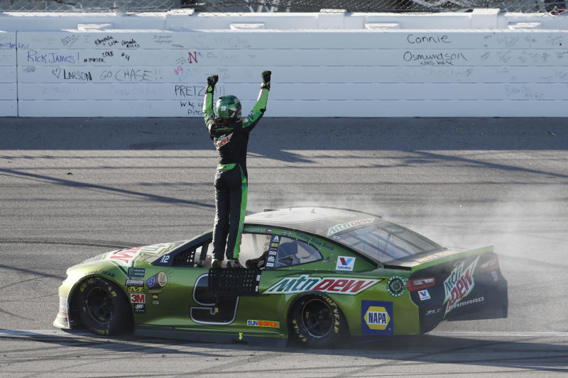 Chase Elliott celebrates after winning a NASCAR Cup Series auto race at Kansas Speedway in Kansas City, Kan., Sunday, Oct 21, 2018. (AP Photo/Colin E. Braley)