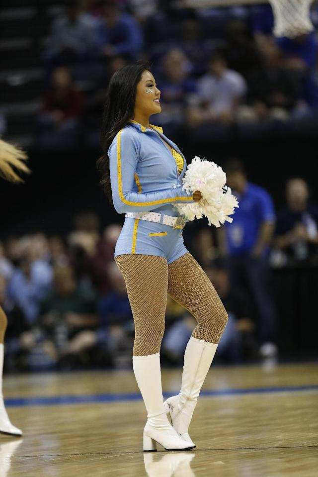 UCLA cheerleaders perform against the Florida during the first half in a regional semifinal game at the NCAA college basketball tournament, Thursday, March 27, 2014, in Memphis, Tenn. (AP Photo/John Bazemore)