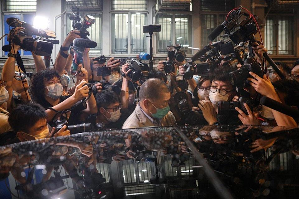 Jimmy Lai is mobbed as he leaves Mong Kok Police Station on bail. Photo: EPA-EFE