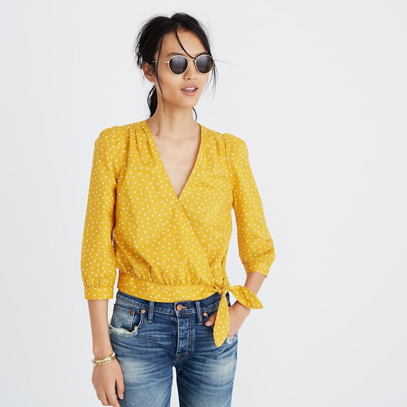 """Get it <a href=""""https://www.madewell.com/madewell_category/SHIRTSTOPS/topsblouses/PRD~G7804/G7804.jsp?Nbrd=M&amp;Nloc=en_US&amp;Nrpp=48&amp;Npge=1&amp;Ntrm=wrap+top&amp;isSaleItem=false&amp;color_name=STARS%20ANT.%20CORAL&amp;isFromSearch=true&amp;isNewSearch=true&amp;hash=row0"""" target=""""_blank"""">here</a>.&nbsp;"""