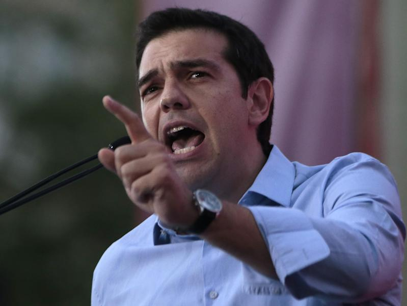 Greece's Left-wing opposition leader Alexis Tsipras addresses his party's supporters during a rally outside Parliament demanding elections, in Athens on Monday June 17, 2013. Exactly one year ago, Greece's conservative prime minister won the mandate to form a coalition government with a daunting brief: Restart punishing reforms, keep the debt-stifled country in the eurozone and end months of political chaos. The latter has proved harder, and Antonis Samaras is now making a last-ditch bid to quell a revolt by key allies over his decision to close the country's state TV and radio broadcaster, axing nearly 2,700 jobs to meet austerity targets. (AP Photo/Dimitri Messinis)
