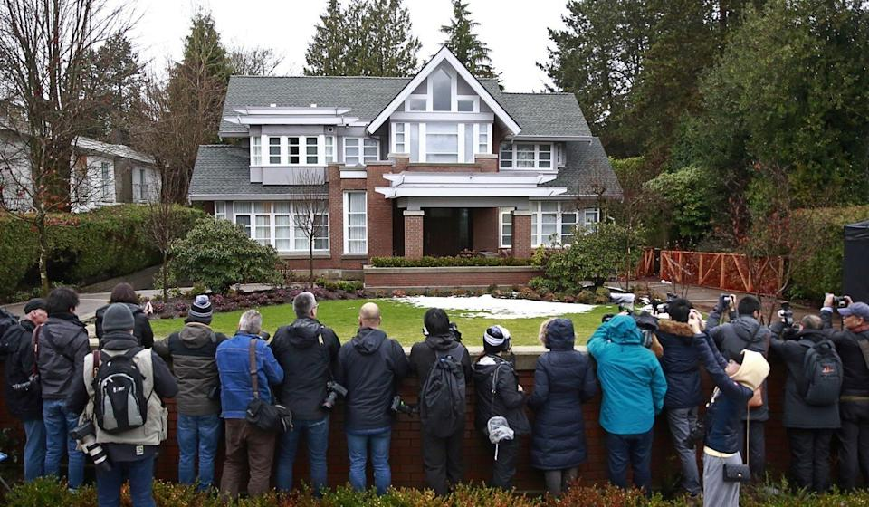 Members of the media standing outside Meng's home on January 20, 2020, in Vancouver. Photo: AFP