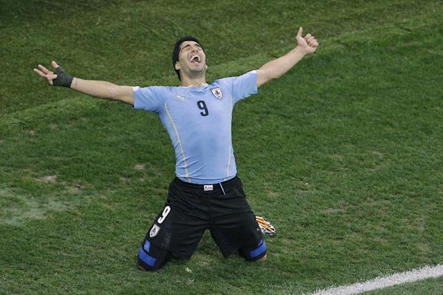 Uruguay's Luis Suarez celebrates scoring 2-1 during the group D World Cup soccer match between Uruguay and England at the Itaquerao Stadium in Sao Paulo, Brazil, Thursday, June 19, 2014. (AP Photo/Michael Sohn)