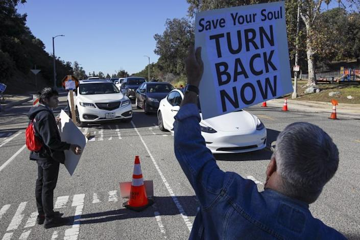 Los Angeles, CA - January 30: A protest organized by Shop Mask Free Los Angeles rally against COVID vaccine, masks and lockdowns at the vaccination site at Dodger Stadium on Saturday, Jan. 30, 2021 in Los Angeles, CA.(Irfan Khan / Los Angeles Times)