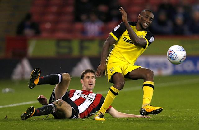 "Soccer Football - Championship - Sheffield United vs Burton Albion - Bramall Lane, Sheffield, Britain - March 13, 2018 Burton Albion's Lloyd Dyer in action with Sheffield United's Chris Basham Action Images/Ed Sykes EDITORIAL USE ONLY. No use with unauthorized audio, video, data, fixture lists, club/league logos or ""live"" services. Online in-match use limited to 75 images, no video emulation. No use in betting, games or single club/league/player publications. Please contact your account representative for further details."