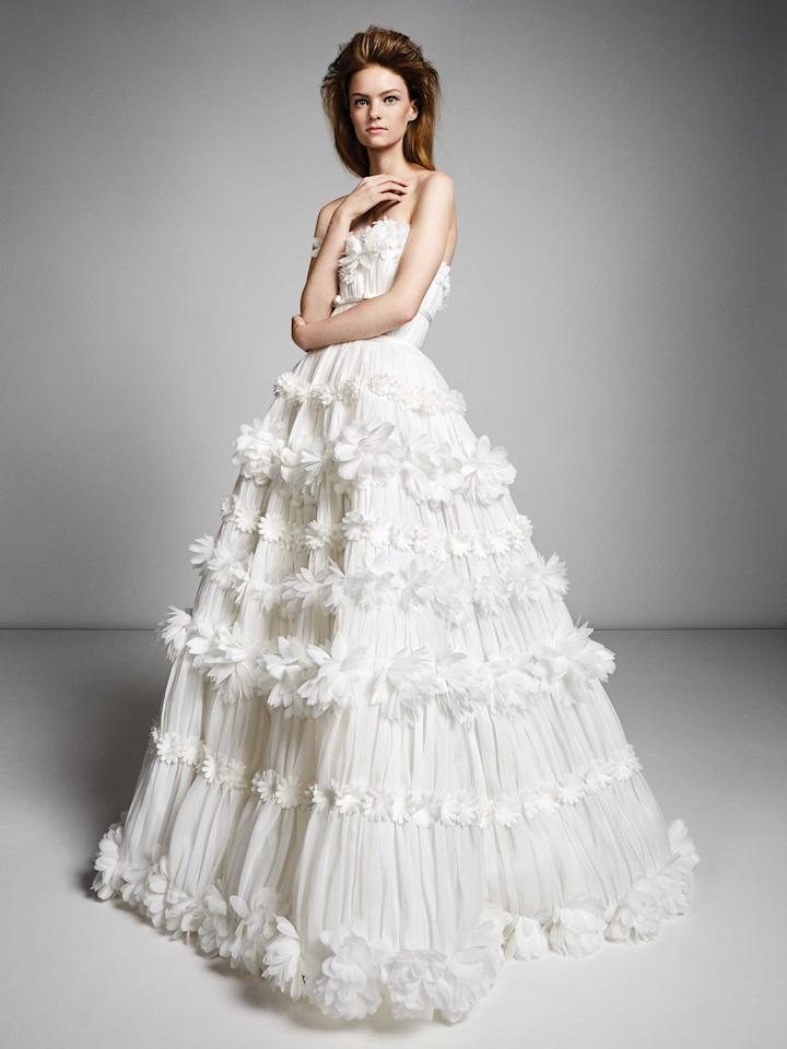 <p>Strapless white pleated gown with floral appliqués. (Photo: Viktor & Rolf Mariage) </p>