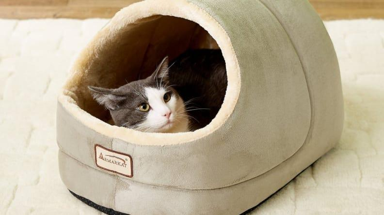 Cats will love hiding away in this cozy enclosed bed.